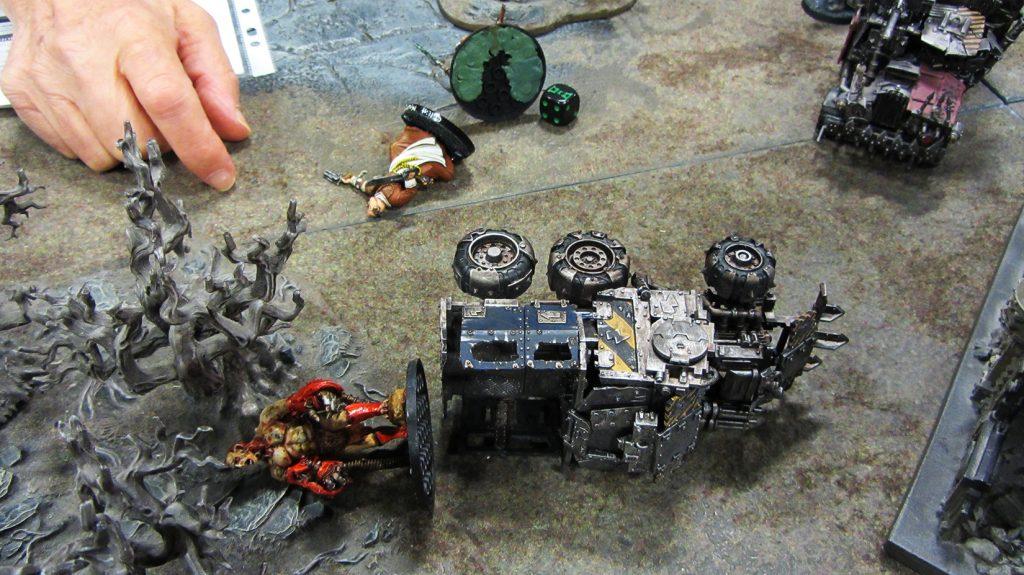 One of Korpik's men has explosive negotiation techniques
