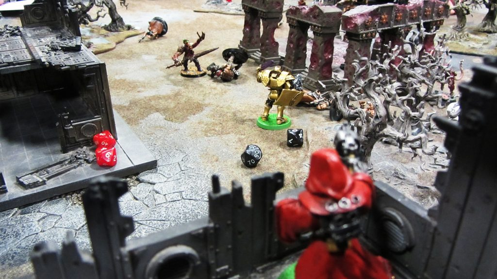 Techpriest Enlin lays down covering fire for Inquisitor Bespin