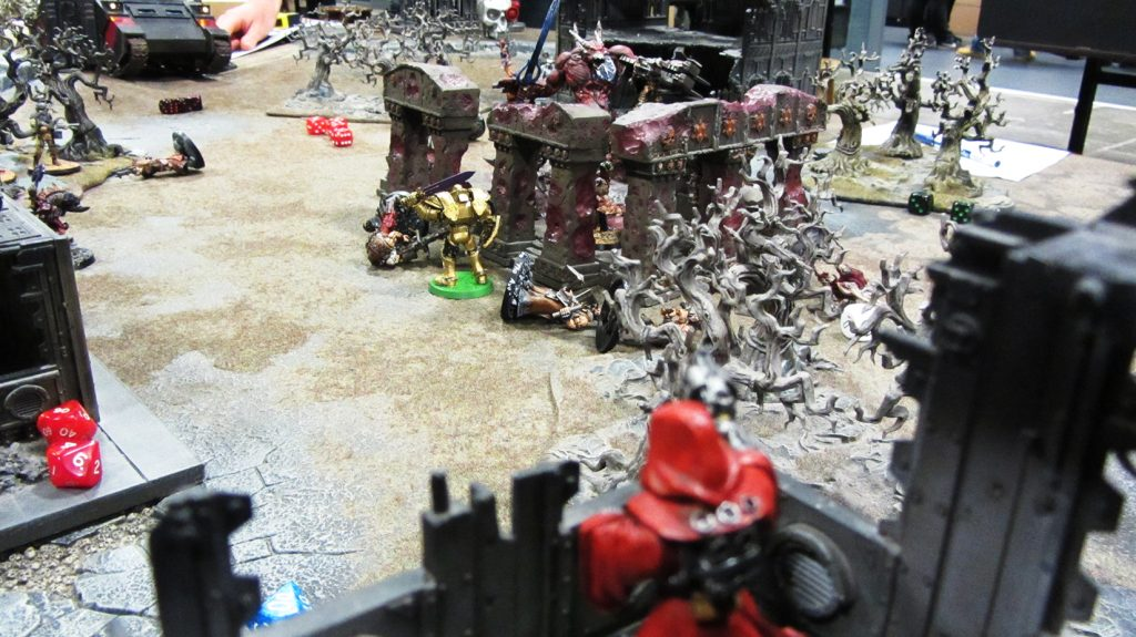 The Techpriest's covering fire proves inadequate against the daemon engine