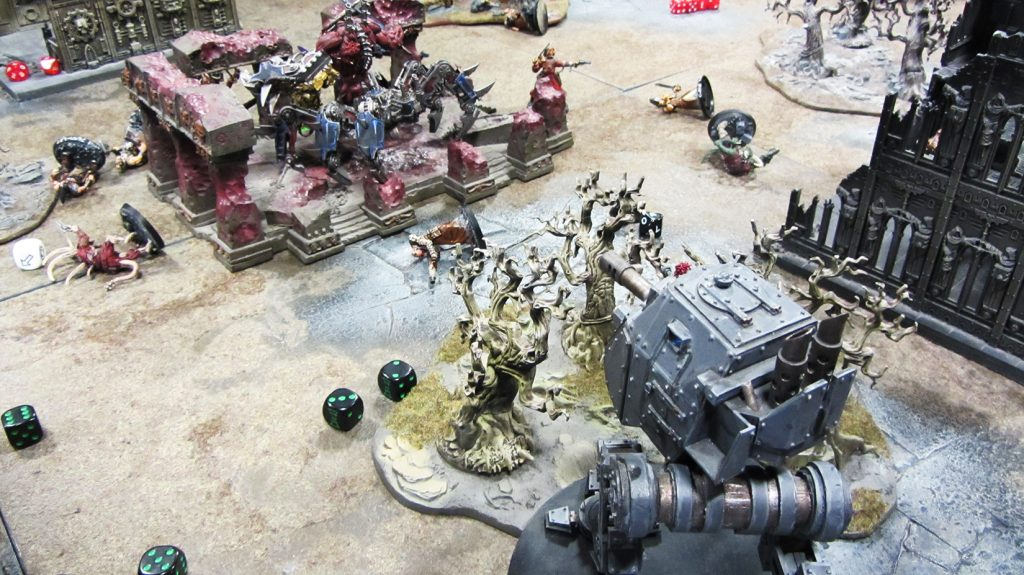 The sentinel pumps autocannon fire into the daemon engine to little effect
